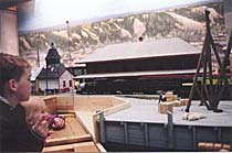 Children enjoying the Whitehorse waterfront model at the Yukon Transportation Museum.